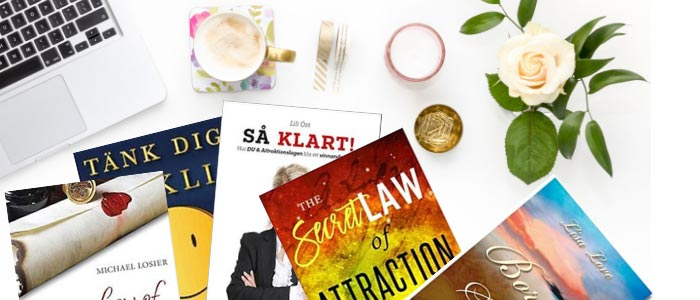 Böcker om attraktionslagen  på skrivbord