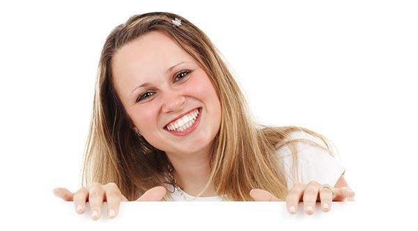 kvinna med vita tänder Tandblekning