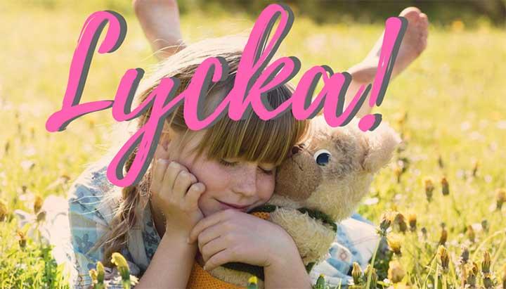 Lycka-flicka med teddy